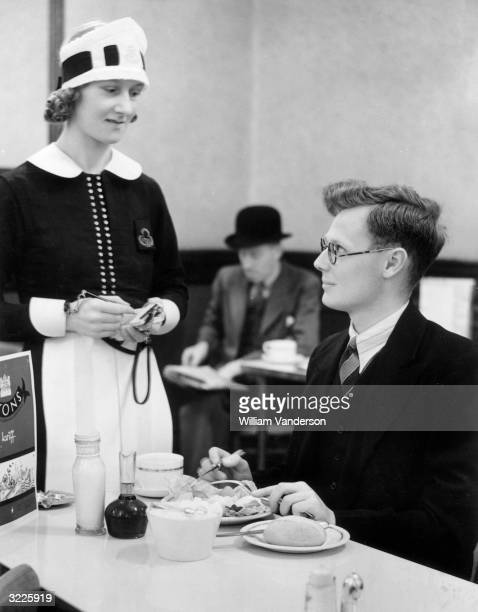 Mr Edwin Barrall an office worker in the City of London enjoys his last 'civvy' lunch at the Lyon's Tea Room in Ludgate Circus The next day he is to...