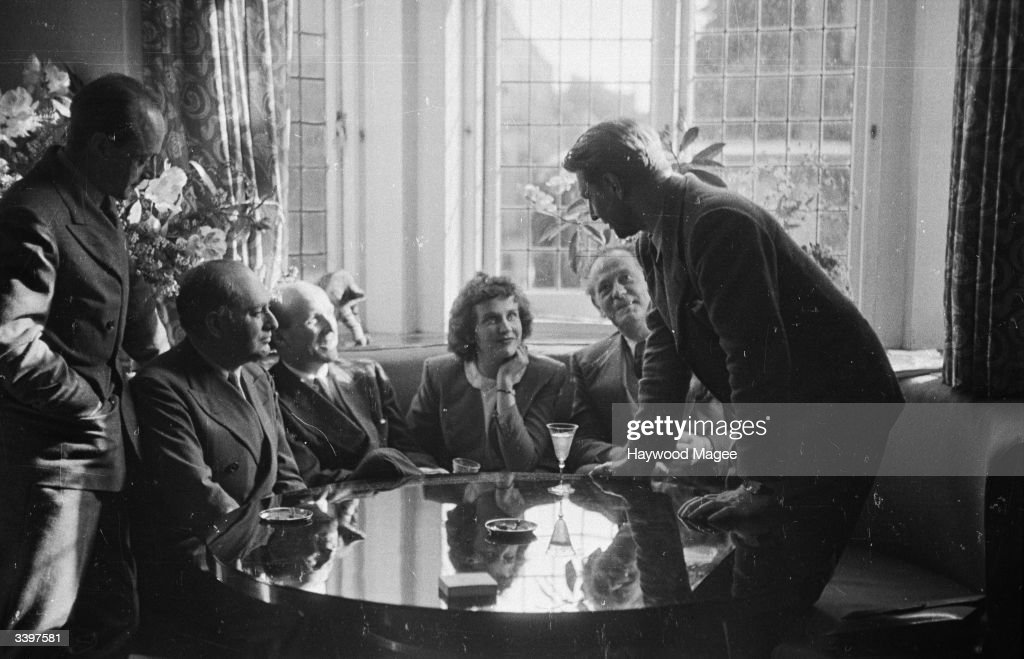 American film actress Kim Hunter (1922 - 2002) talking with film producers Michael Powell, Emeric Pressburger and Roger Livesey, about their forthcoming film 'A Matter Of Life And Death'. Original Publication: Picture Post - 2033 - Lease-Lend Star - pub. 1945