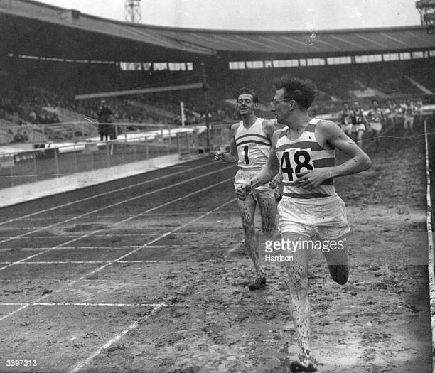 British runner Ken Wood wins the one mile race from Brian Hewson at the Amateur Athletic Association Championships at White City Stadium London