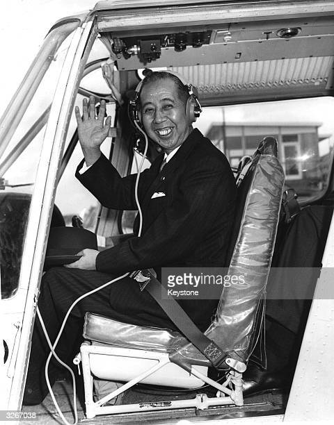 Japanese Prime Minister Nobusuke Kishi aboard a helicopter during a visit to Britain
