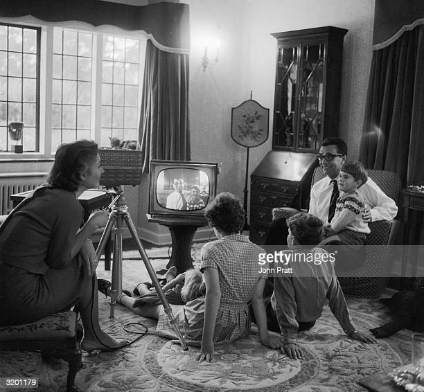 Comedian Michael Bentine trying out a home video kit with his family