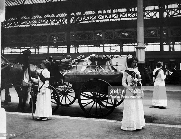 Mrs Yates and Mary Lee guard the coffin of the English suffragette Emily Davison at Victoria Station London
