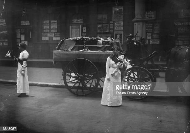 Mrs Yates and Mary Lee guard the coffin of the English suffragette Emily Davison at Victoria Station London Davison died after throwing herself under...