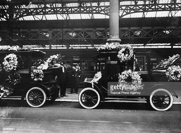 Taxicabs at Victoria Station London covered with wreaths during the funeral of the suffragette Emily Davison