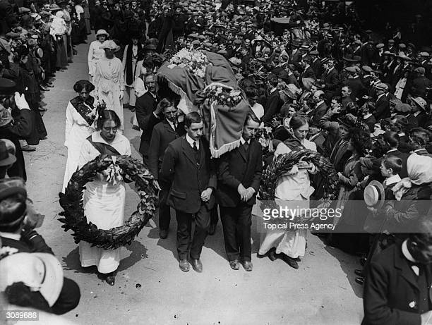The coffin of the suffragette Emily Davison being carried to the graveside in Morpeth