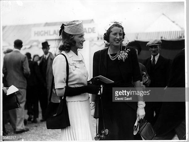 Miss Peggy Hamilton attends the second day of the races at Royal Ascot with a friend both smartly attired in suits and veils