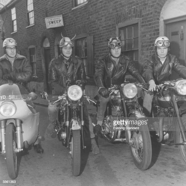 Rockers wearing unusual helmets sit proudly on their tonup cafe racers The bikes are BSA Gold Star Royal Enfield Triumph
