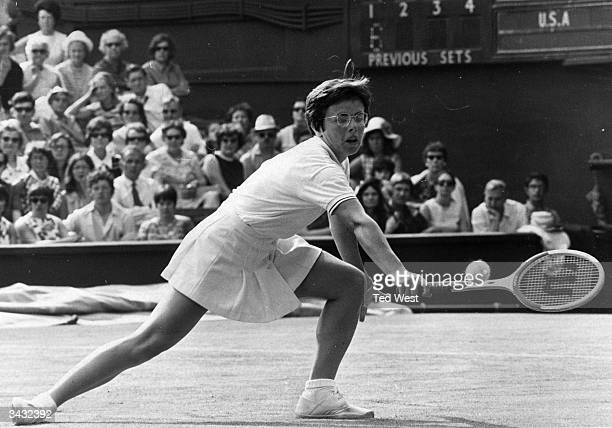 American tennis player Billie Jean King in action against Ann Jones of Great Britain during their Wightman Cup match at Wimbledon