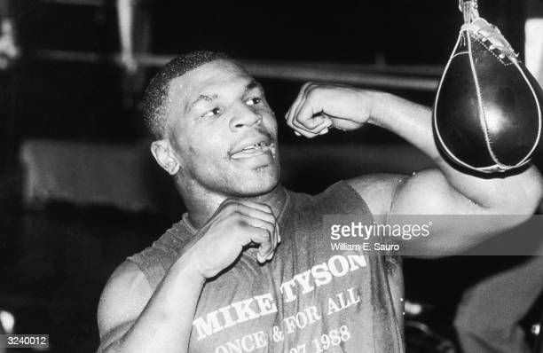 American boxer Mike Tyson trains by hitting a speed bag at Trump Plaza in preparation for his fight with Michael Spinks Atlantic City New Jersey