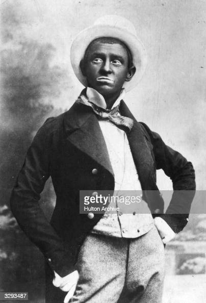 Actor and performer Eugene Stratton is seen blacked up minstral style