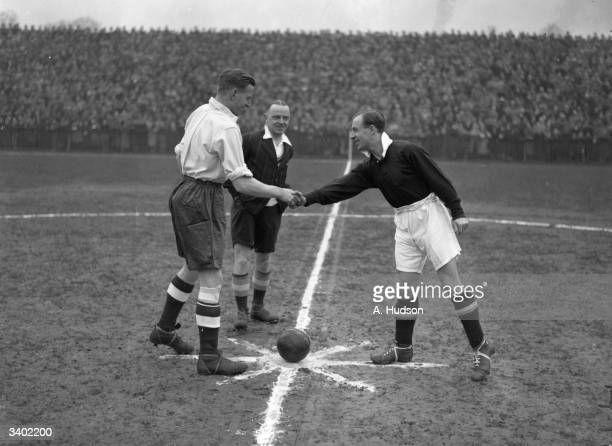 The captains shake hands before the kickoff as England and Scotland amateur international teams play at Dulwich Hamlet's Champion Hill ground They...