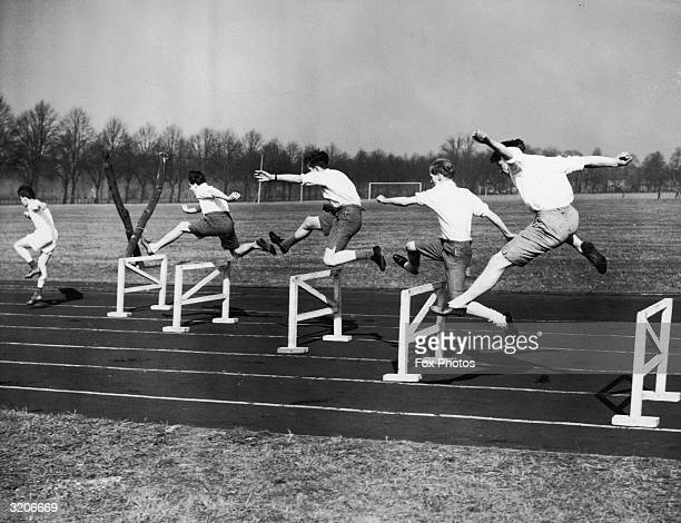 Competitors in the 2nd heat of the low hurdles in the Eton College sports The winner was RF Scrutton