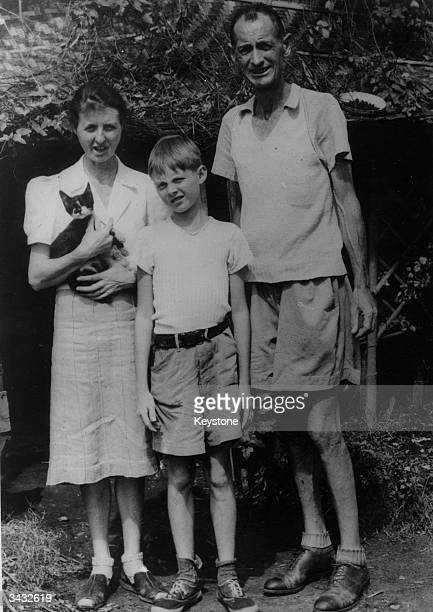 The Matthews family originally from Kent standing in front of their shack in the liberated Japanese prison camp of Santo Tomas in Manila in the...