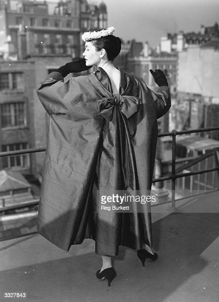 A model wearing the 'Maxime' coat part of the Christian Dior summer collection for the London show The coat is made of a grey shantung organza with a...