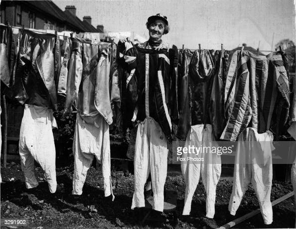 Mrs Burch of Greenford hanging jockeys' washing belonging to the Northolt Park jockeys out to dry