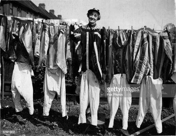 Mrs Burch of Greenford hanging jockeys' washing belonging to the Northolt Park jockeys out to dry
