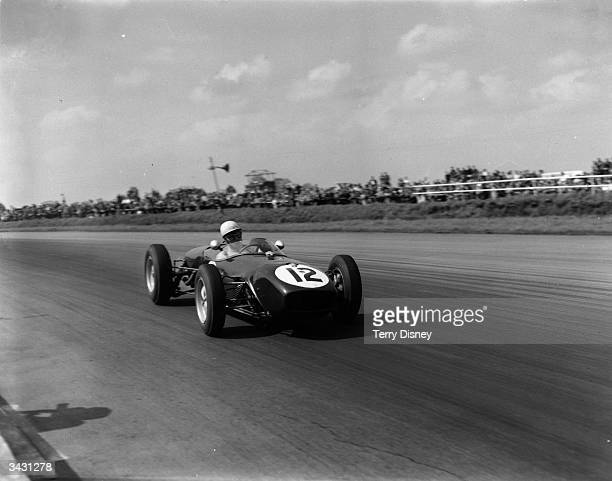 British racing driver John Surtees in action in a Lotus