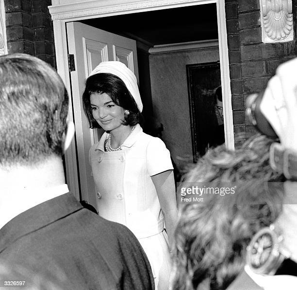 Jackie Kennedy at the door of her sister's house in Buckingham Place She is bound for Runnymede to attend the inauguaration of the memorial to her...