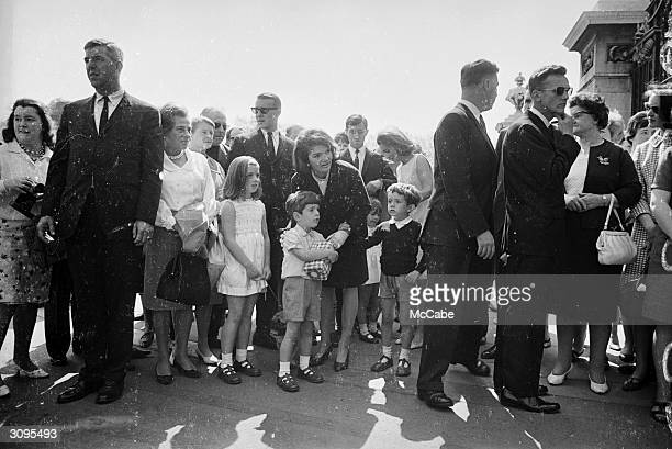 Jackie Kennedy widow of president John F Kennedy standing outside Buckingham Palace during a visit to London with her children John Jr and Caroline...