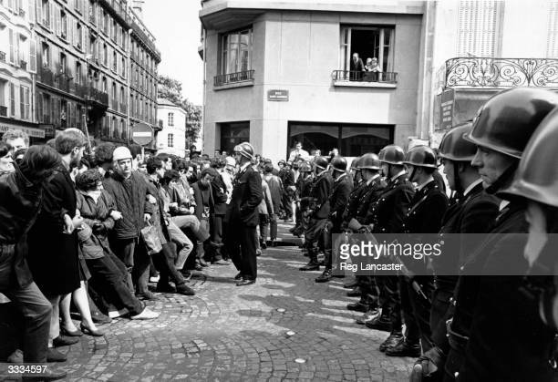 Armed police face a crowd of student demonstrators during the student riots at Paris