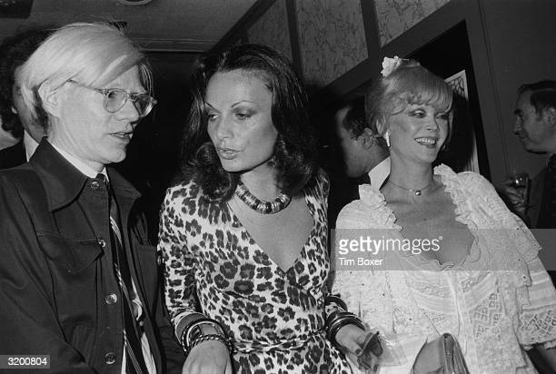 Left to right Artist Andy Warhol fashion designer Diane von Furstenberg and actor Monique Van Vooren star of Warhol's 'Flesh for Frankenstein' at the...