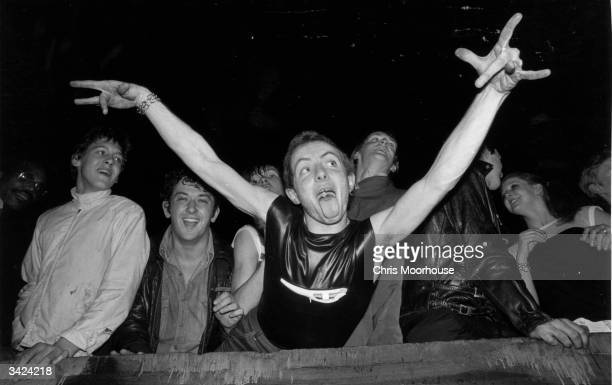 A punk 'spazzing' at the Rainbow Theatre in London while The Clash and The Jam play in concert