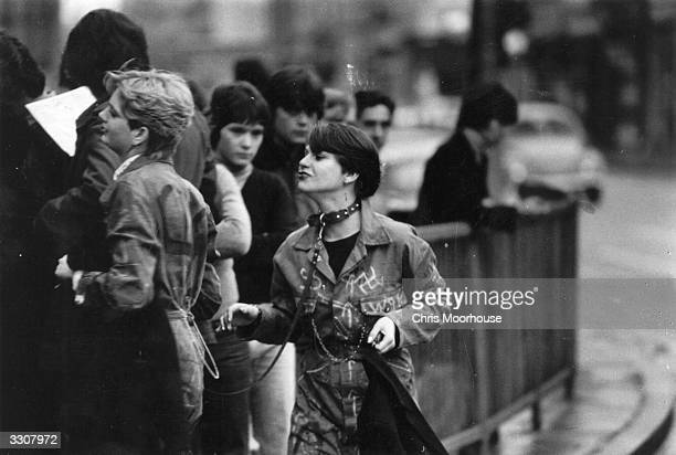A young punk woman on a lead outside the Rainbow London before a gig by The Jam and The Clash
