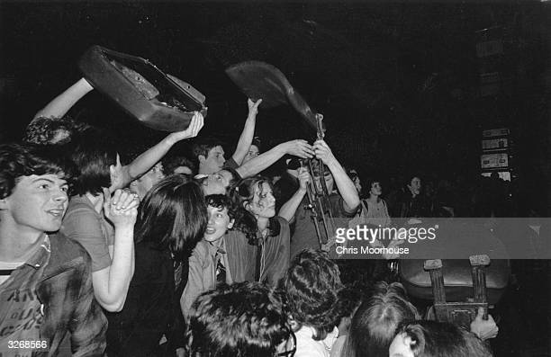 The audience at The Jam and The Clash concert at the Rainbow in London removing seats to make more room for dancing