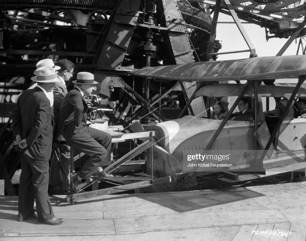 Clarence Brown (1890 - 1987) directs Swedish actress Greta Garbo (1905 - 1990) in an aircraft scene for the film 'Anna Christie', based on the play by Eugene O'Neill.