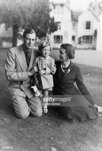 The Duke of Kent with his wife and son Prince Edward in the garden of his country home 'Coppins' in Iver Buckinghamshire