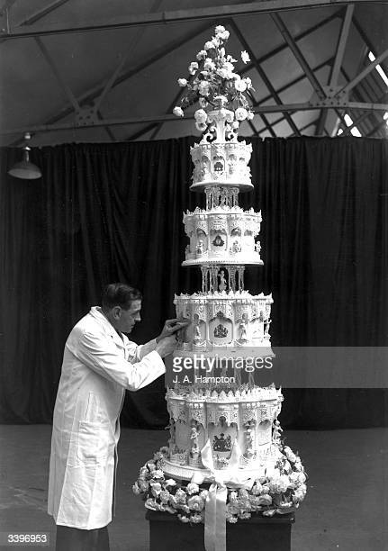 Mr Schur chief confectioner at McVitie and Price putting the final touches to the wedding cake of Princess Elizabeth and The Prince Philip Duke of...