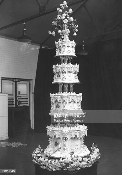 The official wedding cake for HRH Princess Elizabeth's wedding Intricately decorated with armorial bearings of the Princess and Lieutenant...
