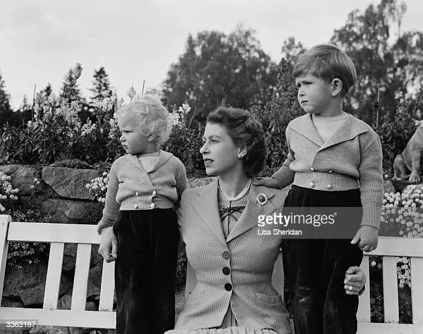 Queen Elizabeth II with Prince Charles and Princess Anne in the grounds of Balmoral Castle Scotland Charles is celebrating his 4th birthday