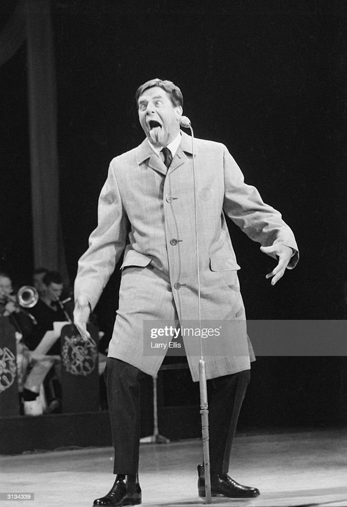 American comic <a gi-track='captionPersonalityLinkClicked' href=/galleries/search?phrase=Jerry+Lewis+-+Comedian&family=editorial&specificpeople=202947 ng-click='$event.stopPropagation()'>Jerry Lewis</a> on stage at the Royal Variety Show.