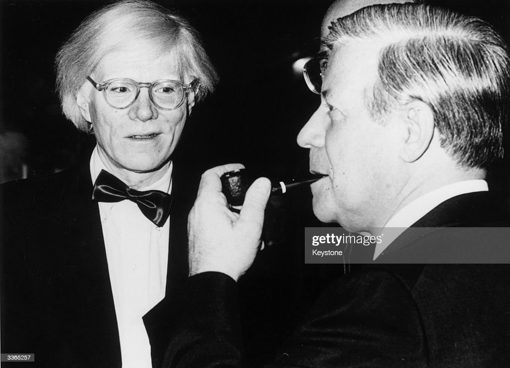 American artist Andy Warhol (1926 - 1987) with German Chancellor Helmut Schmidt at the Federal Press Ball in Bonn.
