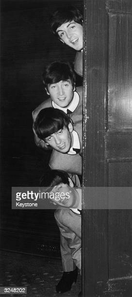 The Beatles Paul McCartney John Lennon George Harrison and Ringo Starr backstage at the London Palladium