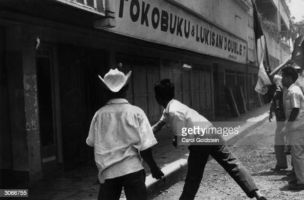 Muslim students in Jakarta Indonesia attacking a Communist bookstore after an aborted communist coup