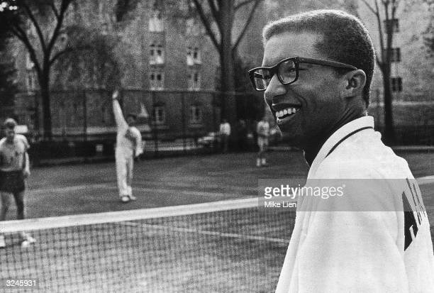 US Army Lieutenant and National Open Tennis Champion Arthur Ashe surveys the courts while cadets practice West Point New York