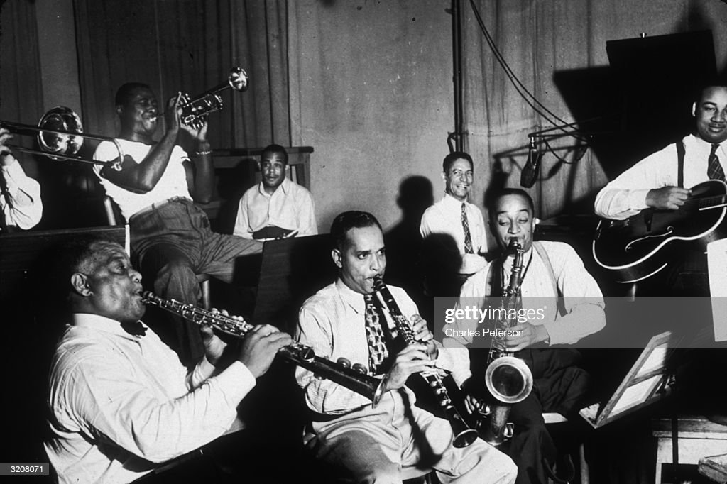 American jazz clarinetist Sidney Bechet (1897 - 1959) plays with other musicians at Jelly Roll Morton's last Victor recording session.
