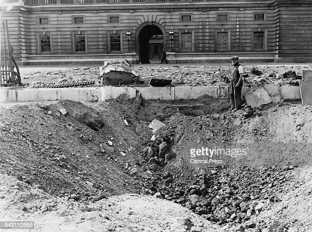 A crater and damaged railings outside Buckingham Palace London after the explosion of a German bomb dropped in an air raid the previous day
