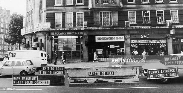 An annotated photograph showing how bank robbers tunnelled into the Baker Street branch of Lloyd's Bank in London from an empty shop two doors away...
