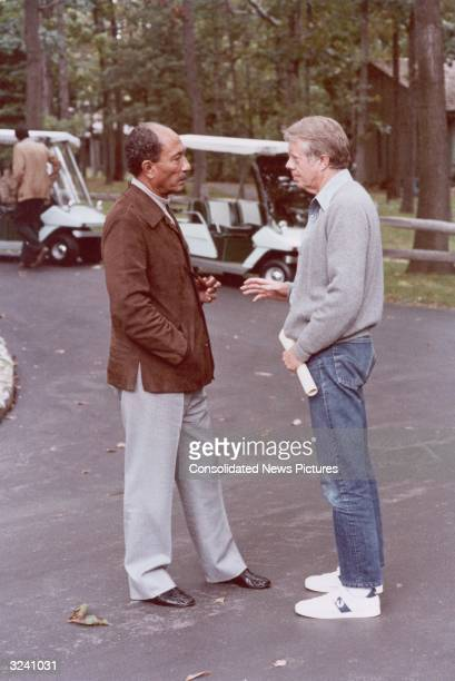 Egyptian President Anwar Sadat and US President Jimmy Carter speak during a break in the Egypt Israel peace agreements Camp David Maryland