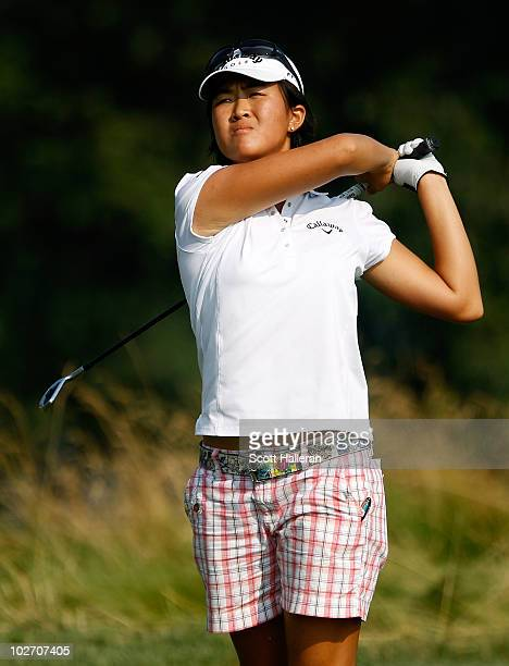14year old amateur Yueer Feng of China watches her tee shot on the 17th hole during the first round of the 2010 US Women's Open at Oakmont Country...