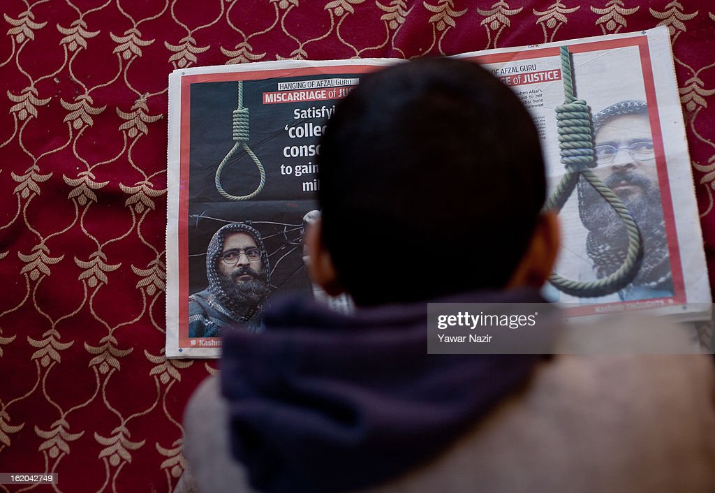 14-year-old Ghalib Afzal Guru, the son of executed Kashmiri separatist Afzal Guru, reads a newspaper at his residence on February 18, 2013 in Jagir, Sopore, 50 km (31 miles) north of Srinagar, the summer capital of Indian-administered Kashmir, India. Guru was secretly hanged and buried at the Tihar Jail in India's capital, New Delhi, on February 9 for his alleged role in the 2001 attack on the country's Parliament. His family alleges that they were kept in dark about the execution by the Indian government . Apprehensive of a massive public fallout over the execution, Indian authorities clamped a curfew for seven consecutive days in Kashmir even as three people were killed allegedly in Indian government forces' action during protests and clashes . Meanwhile, separatist groups have called for a three day strike beginning Wednesday to press the Indian government for handing over of Guru's mortal remains to his family for his last rites, a demand growing louder by the day in Kashmir.