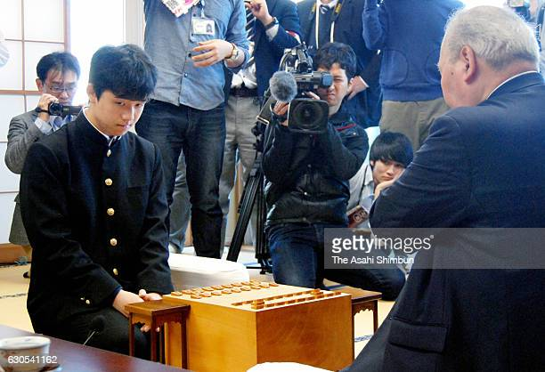 14yearold professional shogi player Sota Fujii and 76yearold Hifumi Kato are seen prior to their contest in the qualification of the Ryuo Title at...