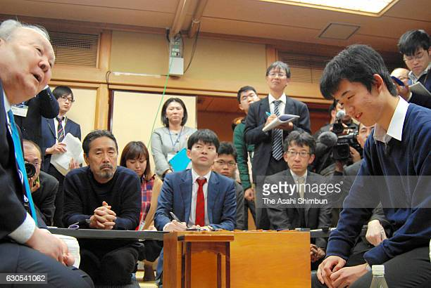 14yearold professional shogi player Sota Fujii smiles after beating 76yearold Hifumi Kato after the qualification of the Ryuo Title at Tokyo Shogi...