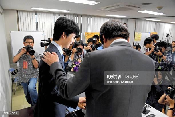 14yearold shogi player Sota Fujii shakes hands with his mentor Masataka Sugimoto after a press conference at Kansai Shogi Kaikan on June 21 2017 in...