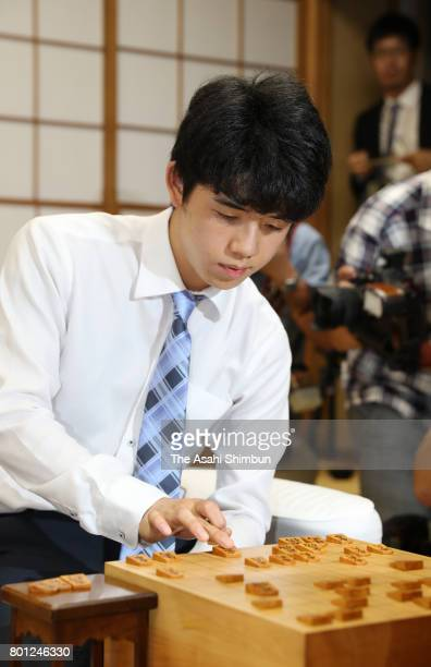 14yearold youngest professional shogi player Sota Fujii reacts after his victory in the Ryuo title tournament round against Yasuhiro Masuda at Shogi...