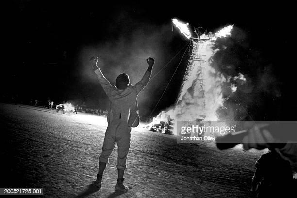 150ft wooden effigy of a 'man' set ablaze on the playa
