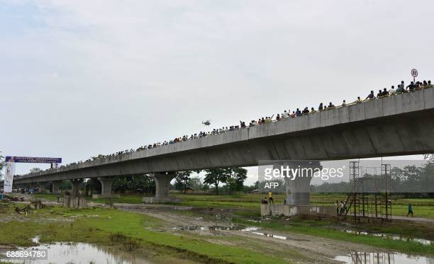 People walk on the DholaSadiya bridge across the River Lohit a tributary of the River Brahmaputra which was inaugurated by Indian Prime Minister...